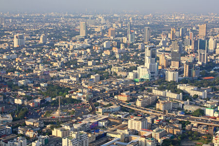 BANGKOK, THAILAND-JAN 05: Aerial cityscape view of Victory Monument and modern buildings from Baiyok Tower on January 05, 2013 in Bangkok, Thailand.