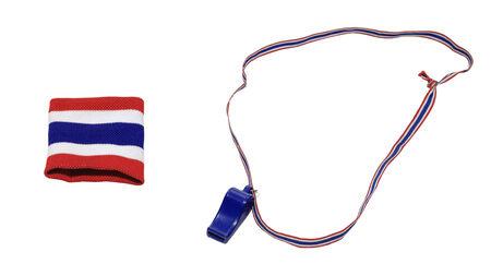 Thai flag wristband and blue whistle isolated on white photo