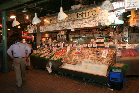 wa: SEATTLE, WA-JUL 10: Customers at Pike Place Fish Co. order fish at the famous public market on July 10, 2007 in Seattle, USA. Here, established in 1965, is famous to see employees throwing fish.