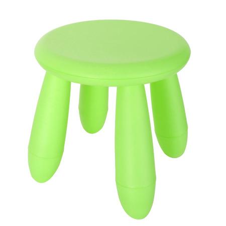 kid green plastic stool isolated on white background photo