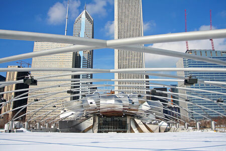 CHICAGO-FEB 09 Jay Pritzker Pavilion with high modern buildings in winter at Millennium Park on February 09, 2008 in Chicago, IL USA  Pavilion hosts concerts and events by capacity for 11,000 people