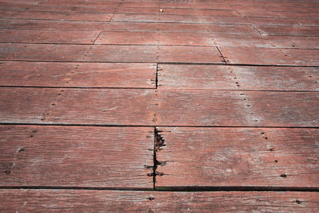 Closeup background of old red plank footpath photo
