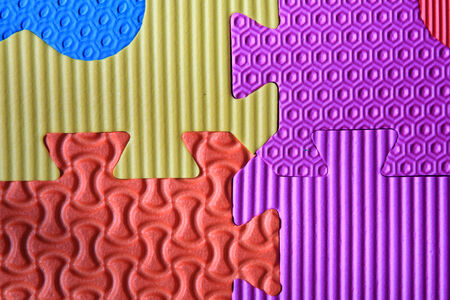 Colorful jigsaw foam texture background photo