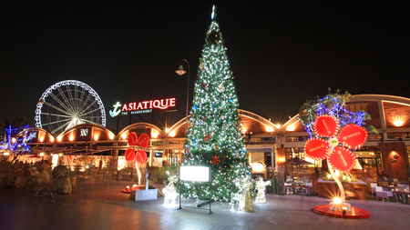 BANGKOK, THAILAND - DECEMBER 05,2012: Unidentified people visit Asiatique The Riverfront with Chrismas tree at night. Three are more than 500 outdoor shopping stores in Asiatique The Riverfront.