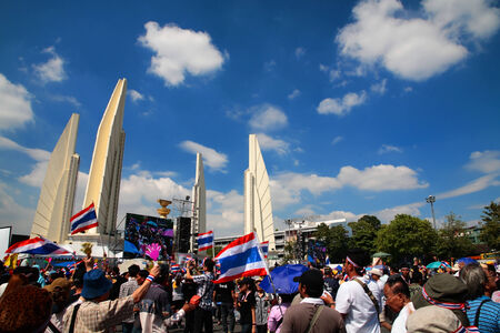 amnesty: BANGKOK, THAILAND - DECEMBER 01, 2013: Thai protesters gather at Democracy Monument to anti government amnesty bill and corrupted Yingluck government. Protesters rally to majority ministries today.