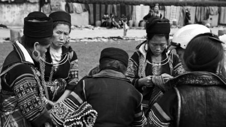 SAPA, VIETNAM - JULY 22, 2012: Unidentified Black Hmongs women with traditional textile from Cat Cat village gather at Sapa city. Many Cat Cat tribes walk about 1 mile to Sapa to sell souvenir.