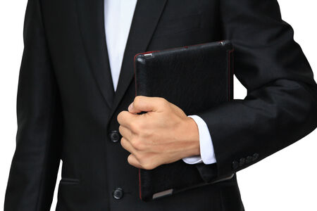 Business man holding digital tablet PC with leather case isolated on white photo