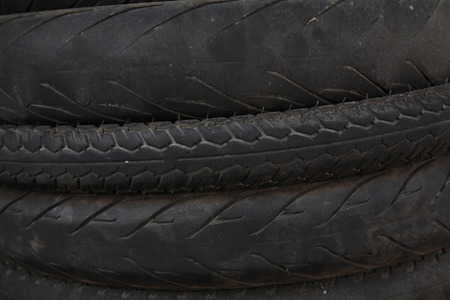 Closeup stack of used bicycle tires photo