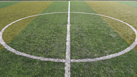 kick off: lines on soccer field with fake green grass at kick off or start spot Stock Photo