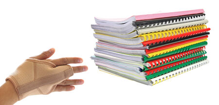 work load: Office syndrome  Hand suffer from work load of many books isolated on white Stock Photo