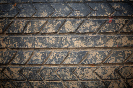 Used grunge crack car tire with brown dirt texture photo