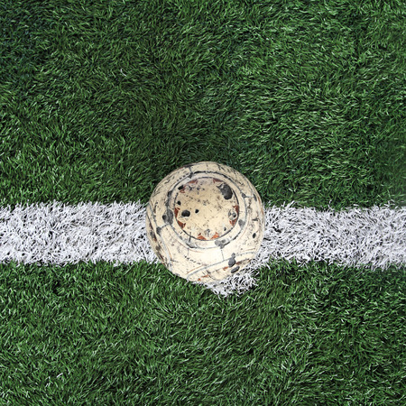Old ball on new soccer ground photo