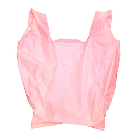 Pink plastic bag isolated on white  photo