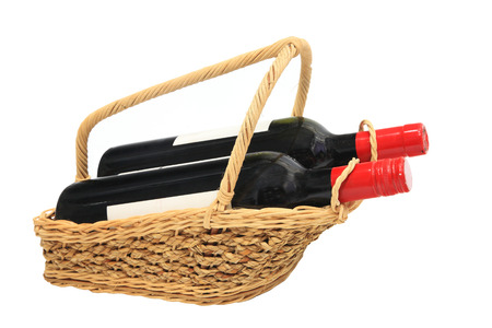 Two Wine bottles in Picnic basket isolated on white  photo