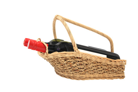Wine bottles on present basket isolated on white background with free space for text photo