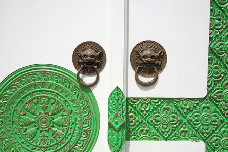 Traditional Chinese Door knocker with green floral carving pattern photo