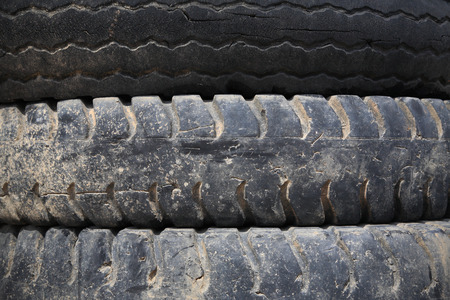 Old Truck tires stacked - background texture photo