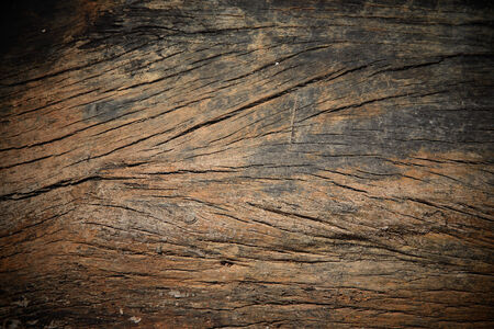 Grungy cracked wooden board by closeup textured background photo