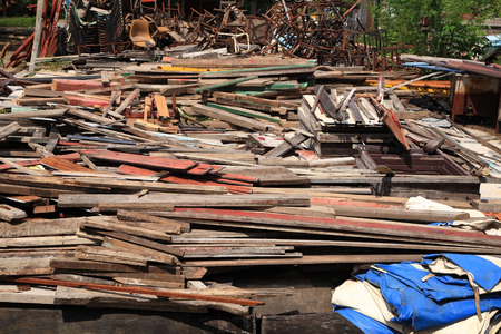 Stack of recycle wooden boards and office supply at recycle center photo