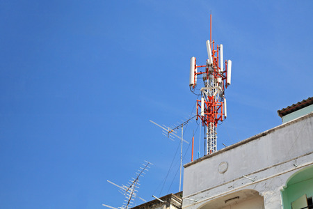 Telecom Communication Building and old fishbone tv antenna on top of building
