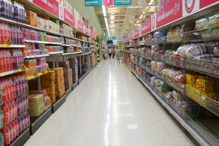 BANGKOK, THAILAND - MAY 31, 2014: Aisle view of Tesco Lotus supermarket. Tesco is the worlds second largest retailer with 6,531 stores worldwide while operates 1,400 stores in Thailand.