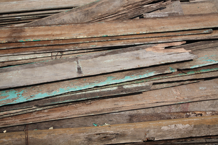 stack of old wooden planks for construction photo