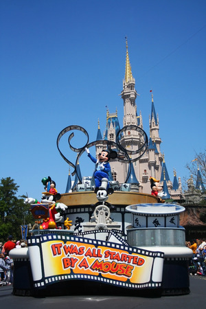 ORLANDO, FL - MARCH 26, 2008: Mickey Mouse during a parade in front of the Disney castle at Magic Kingdom, 1 of theme parks in Disney World.