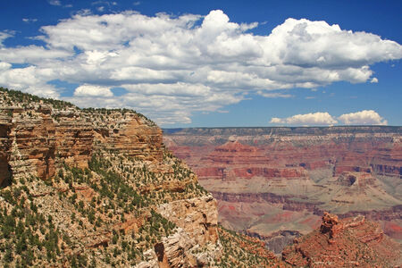 Grand Canyon on sunny day against white cloud and blue sky in Arizona, USA photo