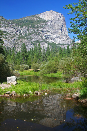vernal: Yosemites half-dome with reflection on the pond