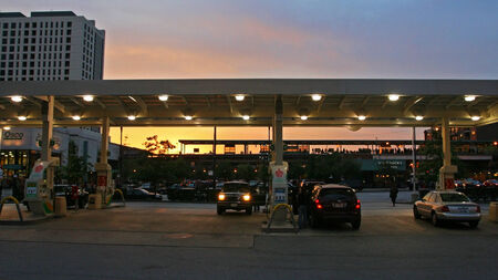 CHICAGO, IL, US - OCTOBER 15, 2007: Unidentified Drivers fill up oil at BP gas station at twilight sky. Illinois is the state with 5th highest average gas price in USA.