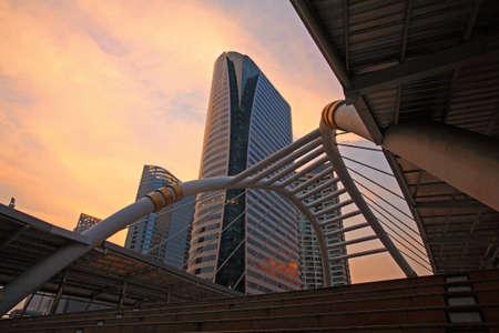 Bangkok skywalk above Sathorn-Narathiwat junction at dusk with twilight sky, Thailand photo