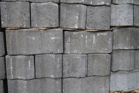 Stack of gray pavement cement bricks texture photo