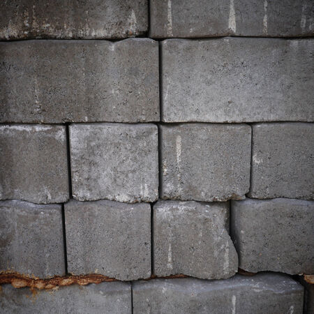 Textured background of gray cement bricks by square shape photo