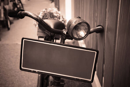 Old bicycle carrying flowers for decoration by Vintage stylized photo photo