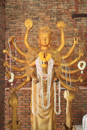 Golden Guanyin with Thousand Arms at wat Salaloi in Korat or Nakhon Ratchasima, Thailand photo