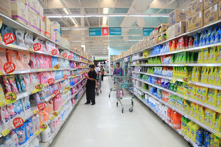 BANGKOK, THAILAND - AUGUST 02, 2014: Unidentified people seeking goods on Aisle at Tesco Lotus supermarket. Tesco is the worlds second largest retailer with 6,531 stores worldwide.