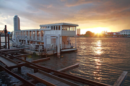 Boat dinner tour on Chao Phraya river at sunset in Bangkok, Thailand photo