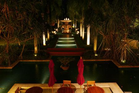 Elephant water fountain at night in luxury gargen