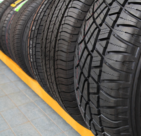 Group of new tires for sale at a tire store photo