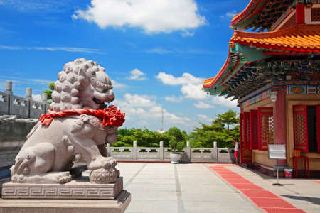 lengnoeiyi: Lion statue in Chinese temple, wat Leng-Noei-Yi, against blue sky, Thailand