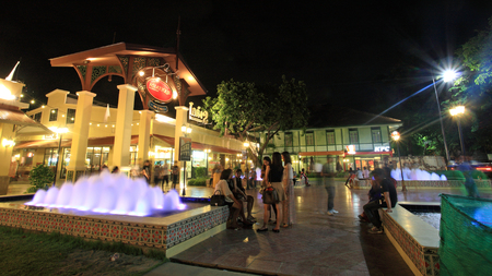 riverfront: BANGKOK-JULY 07, 2012: Unidentified people at Asiatique The Riverfront with fountain. Three are more than 500 outdoor shopping stores in Asiatique The Riverfront.
