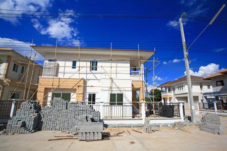 brandenburg home ownership: Modern house under construction against blue sky