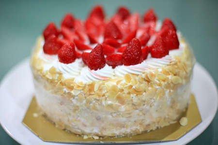 ice-cream cake with many strawberry for birthday party photo