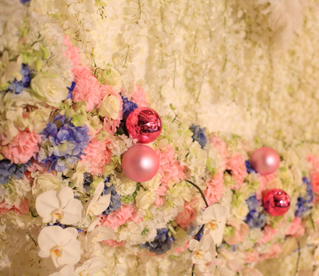 Variety of flowers decoration for indoor wedding reception photo