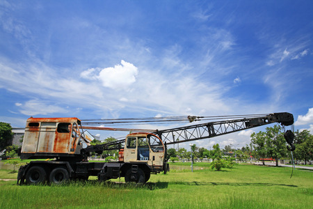 maneuverable: Old automobile crane  with telescopic boom outdoors over blue sky