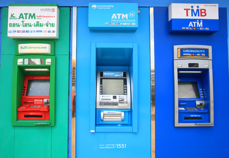 withdraw: BANGKOK, THAILAND -NOVEMBER 15, 2014:ATM units by different Thai banks, Kasikornbank, Krungthai, and TMB. Most of ATMs in Thailand charge 150 bath fee for withdraw from overseas accounts.