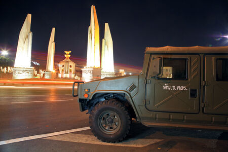 Military Truck parking at Democracy monument at night.Soldiers keep the peace around every important area in Bangkok, Thailand.