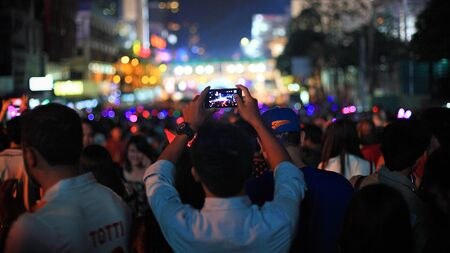 BANGKOK, THAILAND - December 31, 2014: Unidentified man use smartphone to capture countdown happy new year 2015 at central world shopping center.