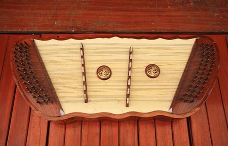 thai musical instrument: Thai wooden dulcimer musical instrument on wooden floor