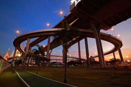 Jogging park under Bhumibol Bridge at dusk in Bangkok, Thailand photo